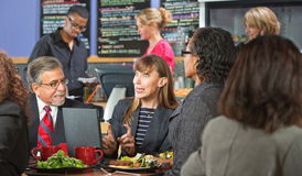 Excited Workers Meeting in Cafe Royalty Free Stock Photos