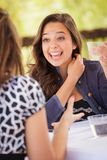 Excited Young Adult Woman Having Drinks and Talking with Her royalty free stock image