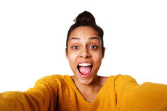 Excited young african lady taking selfie and laughing Stock Photo