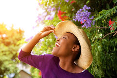 Excited young african woman with hat Stock Photos