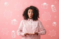 Excited young african woman wearing a shirt stock images