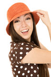 Excited young Asian American cute teen girl wearing orange hat a Stock Images