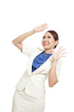 Excited young Asian business woman look up Stock Photo