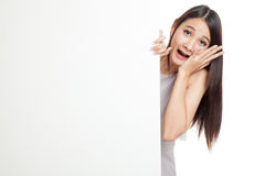 Excited young Asian woman behind  blank sign Stock Images