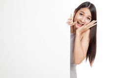 Excited young Asian woman behind  blank sign Stock Photography
