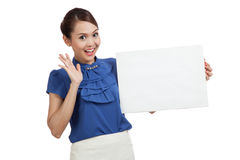 Excited young Asian woman with blank sign Stock Images