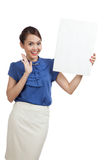 Excited young Asian woman with blank sign Royalty Free Stock Images