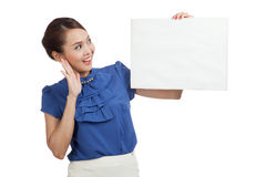 Excited young Asian woman with blank sign Royalty Free Stock Photos