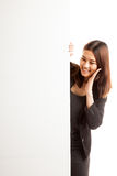 Excited young Asian woman with blank sign. Royalty Free Stock Image