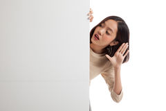 Excited young Asian woman with blank sign Stock Photography