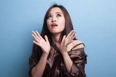 Excited young Asian woman look up. Royalty Free Stock Image