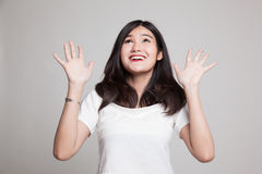 Excited young Asian woman look up. Royalty Free Stock Photography