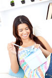 Excited young asian woman opening a present Royalty Free Stock Photos