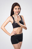 Excited young asian woman showing a bottle of water after doing Stock Image