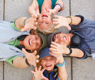 Excited young boys and girls with hands up Royalty Free Stock Images