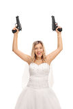 Excited young bride holding two guns Royalty Free Stock Images
