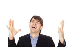 Excited young business man with arms raised in success Stock Photo