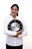 Excited young business woman holding clock in hands Royalty Free Stock Photos
