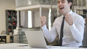 Excited young businessman celebrating success at work stock video footage