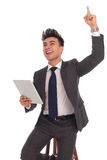 Excited young businessman celebrating victory Stock Images