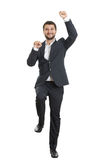 Excited young businessman dancing Royalty Free Stock Image