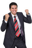 Excited Young Businessman Growling And Grinning Royalty Free Stock Images