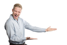 Overjoyed businessperson presenting empty space for text. Stock Images