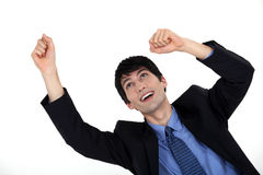 Excited young businessman. Throwing his hands in the air Royalty Free Stock Image