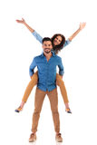 Excited young casual couple Royalty Free Stock Photos