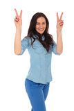 Excited young casual woman showing the victory sign Royalty Free Stock Images
