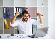 Excited young caucasian businessman celebrate victory cheerful i. N modern office Stock Image