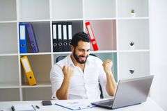 Excited young caucasian businessman celebrate victory cheerful i. N modern office Royalty Free Stock Photography