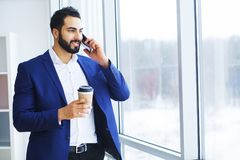 Excited young caucasian businessman celebrate victory cheerful i. N modern office Royalty Free Stock Images