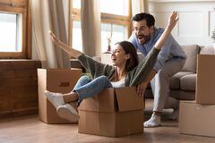 Happy couple have fun on moving day to new home