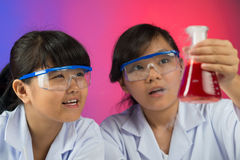 Excited young chemists Royalty Free Stock Images