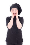 Excited young cook woman in black uniform isolated on white Stock Photos