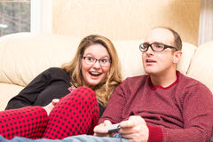 Excited Young couple plays video game Royalty Free Stock Photos