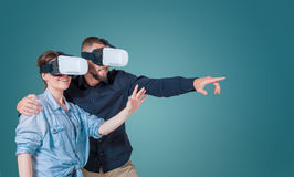 Excited young couple using a VR headset glasses