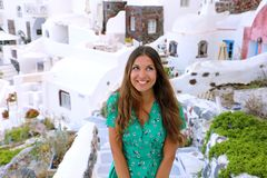 Excited young fashion woman exploring Oia small town in Santorini Island, Greece. Lovely tanned girl looking to the side wishing or dreaming in Santorini Stock Images