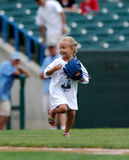 Excited young female baseball fan Royalty Free Stock Images