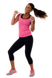 Excited young female fitness trainer Royalty Free Stock Photos