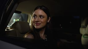 Excited young female star greeting public and photographers from car, fame. Stock footage stock video
