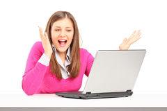 Excited young female working on laptop royalty free stock photo