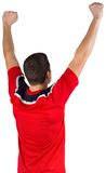 Excited young football player cheering Stock Image