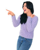 Excited Young Girl. Young beautiful woman in purple dress pointing and laugh royalty free stock photo