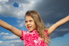Excited Young Girl against Cloudy Sky Stock Photography