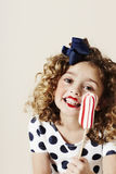 Excited young girl with candy Stock Images