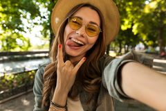 Excited young girl in hat and sunglasses royalty free stock photography