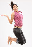 excited young girl in jumping posture Stock Images