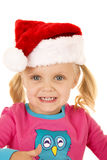 Excited young girl smiling wearing a santa hat Royalty Free Stock Photography